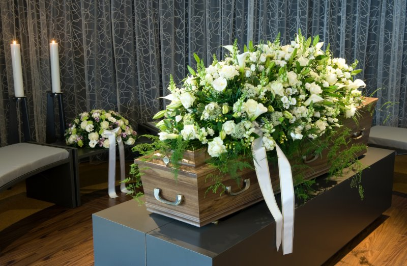 funeral casket and flowers